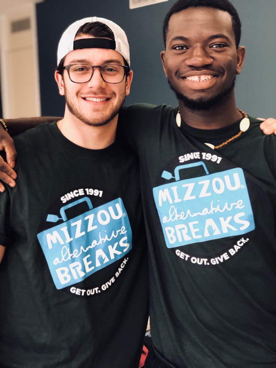 Two students serving at the Houston Food Bank in March of 2018.